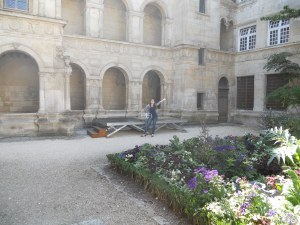 My harpist, Jess, beside the stage for our courtyard concert at the Centre Intermondes